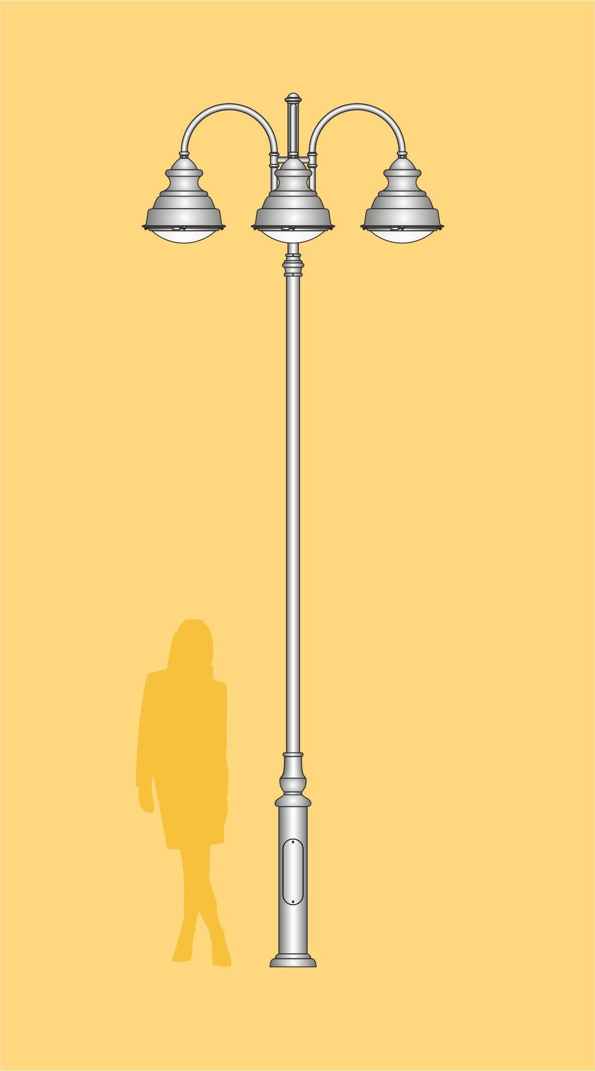 Wysoka latarnia uliczna z 4 oprawiami skierowanymi na drogę dając odpowiednie oświetlenie po zmroku